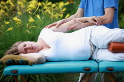 Pregnant woman arm massage by physical therapist